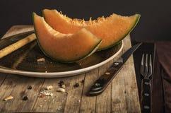 Oranje meloen zwarte achtergrond Royalty-vrije Stock Foto