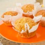 Oranje muffins Stock Afbeeldingen
