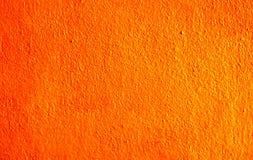 Oranje muurachtergrond Stock Fotografie