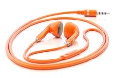 Oranje oortelefoons Stock Foto