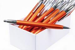 Oranje pennenachtergrond Royalty-vrije Stock Foto's