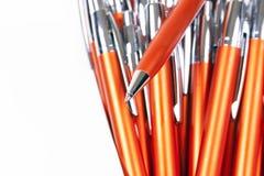 Oranje pennenachtergrond Royalty-vrije Stock Fotografie
