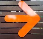 Oranje pijl Stock Foto