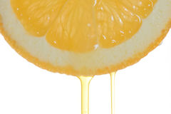 Oranje plak met een druppeltje royalty-vrije stock afbeeldingen
