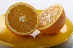 Oranje plakken op schotel Stock Fotografie