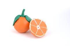 Oranje plakken van sappige plasticinesinaasappelen Stock Afbeeldingen