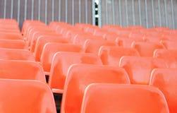 Oranje plastic bleachers Stock Afbeeldingen