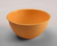 Oranje plastic diepe schotel Stock Foto