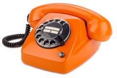 Oranje retro telefoon royalty-vrije stock foto's