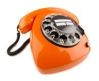 Oranje retro telefoon stock foto's