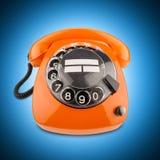 Oranje retro telefoon royalty-vrije stock foto