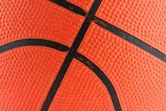 Oranje rubberbasketbal macroachtergrond Stock Foto