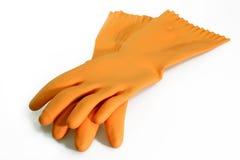 Oranje rubberhandschoenen Stock Foto