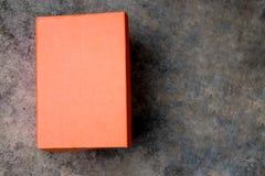 Oranje schoendoos met gesloten deksel royalty-vrije stock foto's