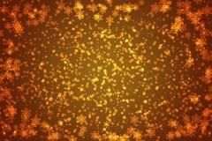 Oranje sneeuwvlokkenachtergrond of frame Royalty-vrije Stock Foto's