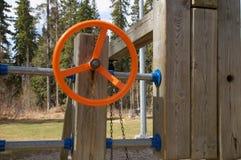 Oranje Speelplaatsstuurwiel Stock Fotografie