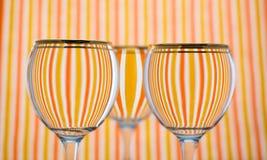 Oranje streepglas water Stock Foto