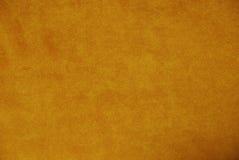 Oranje suèdeachtergrond Stock Foto's