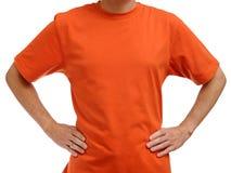 Oranje t-shirt op de jonge mens Stock Foto