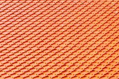 Oranje tegeldak bij Boeddhistische tempel Vierkante patroonachtergrond stock foto's