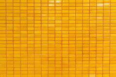 Oranje tegelmuur Stock Afbeelding