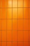 Oranje tegelsmuur Stock Foto's