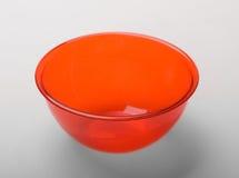 Oranje transparante plastic diepe schotel Stock Foto