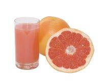 Oranje versheidsgrapefruit met sap Stock Fotografie