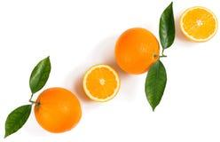 Oranje vruchten, de helften en wholes Stock Afbeelding