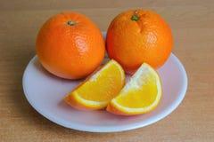 Oranje vruchten op de lijst Stock Fotografie