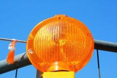 Oranje wegwaarschuwingssein Stock Foto