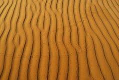 Oranje zacht woestijnzand Royalty-vrije Stock Foto's