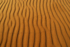 Oranje zacht woestijnzand Stock Foto's