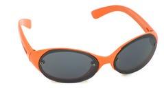 Oranje zonnebril. Stock Foto's