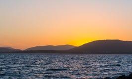 Oranje zonsondergang in Alghero royalty-vrije stock foto