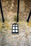 Oranjemolen in Vlissingen, Netherlands. Detail of a window in the wall of a mill. The windmill is on a dike near the Westerschelde Royalty Free Stock Image