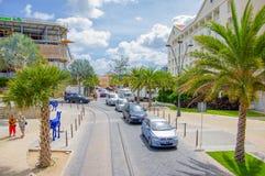 ORANJESTAD, ARUBA - NOVEMBER 05, 2015:Streets of. ORANJESTAD, ARUBA - NOVEMBER 05, 2015: Streets of Aruba Island, downtown shopping district with tram tracks Stock Photo