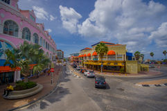 ORANJESTAD, ARUBA - NOVEMBER 05, 2015:Streets of. ORANJESTAD, ARUBA - NOVEMBER 05, 2015: Streets of Aruba Island, downtown shopping district with tram tracks Royalty Free Stock Photography