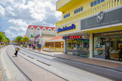 ORANJESTAD, ARUBA - NOVEMBER 05, 2015:Streets of. ORANJESTAD, ARUBA - NOVEMBER 05, 2015: Streets of Aruba Island, downtown shopping district with tram tracks stock photo