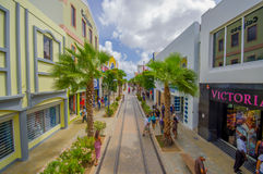 ORANJESTAD, ARUBA - NOVEMBER 05, 2015:Streets of. ORANJESTAD, ARUBA - NOVEMBER 05, 2015: Streets of Aruba Island, downtown shopping district with tram tracks stock images