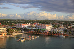 Oranjestad, Aruba, Skyline. The skyline of Oranjestad, Aruba,showing the main shopping buildings. Moored small craft are in the foreground. Pink morning clouds Royalty Free Stock Image