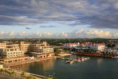 Oranjestad Harbor, Aruba. The small craft harbor of Oranjestad, capital of Aruba. The major shopping area is on the right and office buildings are on the left Royalty Free Stock Images