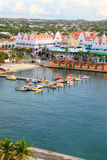 Oranjestad Harbor, Aruba. The end of the Oranjestad, capital of Aruba, Harbor. It shows the small fishing boats in the middle. Towards the top is the Royal Plaza Royalty Free Stock Photography