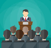Orator speaking from tribune. crowd on chairs Royalty Free Stock Image