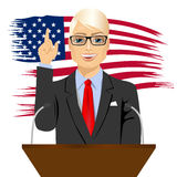 Orator standing behind a podium with microphones Stock Image