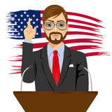 Orator standing behind a podium with microphones Royalty Free Stock Photos