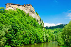 Orava Castle background of green trees, Slovakia Stock Image