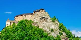 Orava Castle, green trees with blue sky, Slovakia Royalty Free Stock Photography