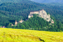 Orava castle. In the morning behind yellow field stock photo