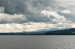 Cloudy Orava. Orava with heavy clouds and rain stock image